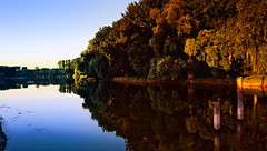 At a lake in the evening (lucianomandolina) Tags: see abend wald bäume himmel blau rot wasser spiegelung lake evening forest trees sky blue red water reflection
