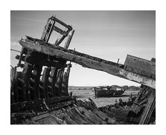 Wrecks-2 (D_M_J) Tags: fleetwood marsh nature reserve lancashire landscape uk england north west fylde coast river wyre ship shipwreck boat boats wreck abandoned film camera large format 4x5 5x4 shen hao hzx45 150mm sinar sinaron ilford delta 100 pro kodak hc110 epson v850 vuescan black white bw blackandwhite mono monochrome