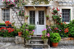 Spring Flowers in Perast (Jocelyn777) Tags: houses stonehouses stone architecture doorsandwindows doors windows flowers plants foliage villages perast montenegro travel