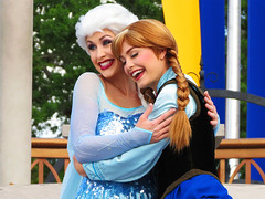 Elsa and Anna (meeko_) Tags: elsa anna queen queenelsa princess princessanna characters disneycharacters frozen mickeys royal friendship faire mickeysroyalfriendshipfaire show entertainment castleforecourtstage fantasyland magic kingdom magickingdom themepark walt disney world waltdisneyworld florida