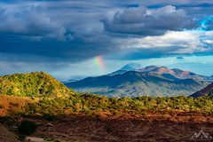 Lucky Landscape (Dustin James Bogs) Tags: volcano rainbow storm wanderlust nicaragua leon volcanoday tourism sky clouds travel landscapes nature adventure hiking centralamerica pacificocean ocean world environment climbing latinamerica passport tourguide colombia northface topical landscape sea sun mountain telica tree grass