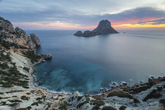 Es Vedrà. (dasanes77) Tags: canoneos6d canonef1635mmf4lisusm tripod landscape seascape wind cloudscape sunset colors orange yellow blue bluehour sea ocean island ibiza balearicislands cliff rocks