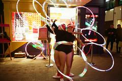 Dancing lights (srgpicker) Tags: 35mm 400 f²400 analog f2400 film iso400 lomography london mjuii olympus carnaby carnabystreet swatch girls hula lights dancing performance μmjuii centrofuji