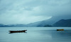 Lugu lake in rain 天青色等烟雨,而我在等你 (Angelica sinensis) Tags: lake boat rain scenery 湖 船 风景 雨景意境