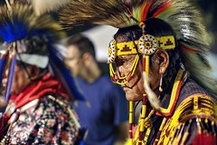 Critical eyes of a judge (PeterThoeny) Tags: stanford stanforduniversity california siliconvalley sanfranciscobay sanfranciscobayarea southbay powwow stanfordpowwow festival competition dance costume americanindian portrait person judge feather light night sony a7 a7ii a7mii alpha7mii ilce7m2 fullframe vintagelens dreamlens canon50mmf095 canon 1xp raw photomatix hdr qualityhdr qualityhdrphotography