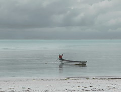 The Lonely Fisherman (louise peters) Tags: fishing vissen fisherman visser boat boot vissersboot sea zee water beach strand clouds wolken wolkenlucht sand zand man person hengel pingwe zanzibar tanzania africa afrika seascape zeegezicht indianocean indischeoceaan