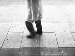 (Denkrahm) Tags: walk blur sidewalk desolate newspaper paper oldman morning genève