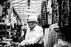 Torebki 247.365 (ewitsoe) Tags: canoneos6dii city cityscape ewitsoe polska spring street sunny warszawa erikwitsoe poland urban warsaw man forard blur outoffocus sign alley shops market feel environment atmosphere blackandwhite bnw monochrome mono