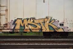 MSTK (TheGraffitiHunters) Tags: graffiti graff spray paint street art colorful freight train tracks benching benched tropicana reefer car mstk ribbet