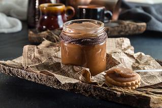 Jar of salted caramel. Traditional recipe of salty caramel of shugar, butter and milk cream.