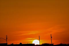 Sunset 13 Orange power (darletts56) Tags: sky orange cloud clouds sun buildings post posts light dusk sunset white power