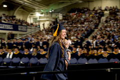 Happy University Graduation Walk with Baby (aaronrhawkins) Tags: graduate graduation college university byu brighamyounguniversity mother mom baby daughter engineering mechanical crowd stand stage walk ceremony robe tassle hat family girl woman proud thrill happy joy provo utah aaronhawkins smithfieldhouse campus smile glow pan panning action moment degree bachelors bs spring future procession accomplish accomplishment completion multitasking multitask radiant beautiful diploma convocation school