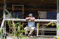 Contemplation - Hagood Mill - Pickens, S.C. (DT's Photo Site - Anderson S.C.) Tags: canon 6d 135mmf2l lens hagood mill upstate pickenssc southcarolina man hat thinking relaxing rail porch southernlife enjoyment southern america usa home house aged
