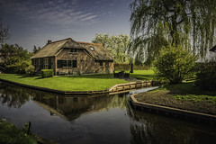 giethoorn (wimvandemeerendonk, back from Lofoten) Tags: water reflection weerribben architecture ditch green color colors colours colour landscape netherlands nederland outdoors outdoor overijssel sony thenetherlands tree trees blossom wimvandem wetlands giethoorn ☯laquintaessenza☯