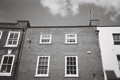 A022331-R1-28-29-1.jpg (theoldsmithy) Tags: xa2 olympus acros 35mm film hereford building herefordshire brick wall