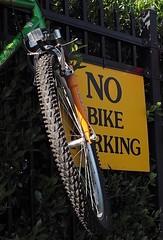 050618FSJ-07c (djfnola) Tags: davidfischer olympus mzuiko1240mm28pro neworleans la louisiana faubourgstjohn fsj jazzfest sunday close nobikeparking bike fence fortinstreet