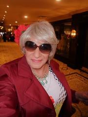 I Have Arrived! (Laurette Victoria) Tags: raincoat blonde sunglasses laurette woman hotel milwaukee pfisterhotel