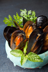 Mussels baked with butter and parsley in blue ceramic bowl and sauce bowl on dark background (alena.alekseeva.rudenko) Tags: mussels seafood food black lemon recipe snack bowl blue eating gourmet grill baked barbecue shellfish topview above overhead copyspace top plate parsley view background clam sea delicious dinner meal sauce fresh cooked dark healthy cuisine dieting appetizer mollusk