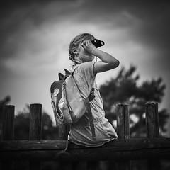 Young explorers 1 (PascallacsaP) Tags: grootepeel binoculars monochrome portraiture fujifilm blackandwhite filmsimulation acros fence exploringnature vignetting bokeh fujineopan100 zhongyimitakonspeedmaster35mmf095markii portrait sky creamy noir