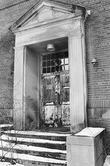Abandoned School (ComradePhoto) Tags: abandoned minoltamaxxum7000 ilford ilforddelta400 minolta hospital school blackwhite door danger