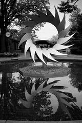 Goodnight, Gardens (Anne Marie Clarke) Tags: markchai modern sculpture pineapple georgiaokeeffe newyorkbotanicalgarden frame clock closing reflection pool hawaii blackandwhite monochrome uprightformat crazytuesdaytheme 7dwf