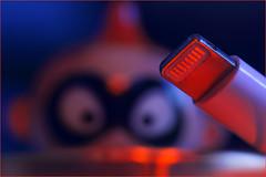 Beam me up Scotty. Alias Jack. (Gudzwi) Tags: plug jack macro macromondays macroorcloseup macromonday makro light lighting lightandshadow redlight redandblue rot rotundblau roteslicht robbie figure figur spielzeugfigur toyfigure macromondays2018april30plugandorjacks plugandorjacks beammeupscotty stecker ladekabel chargecable hmm happymacromonday startrek bokeh raumschiffenterprise smartphone kunstlicht availablelight tageslicht verschwommen blurry blur unschärfe