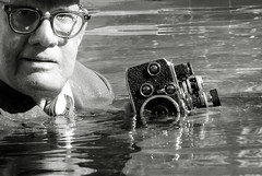 Movie camera spoof, era 1961 (clarkfred33) Tags: camera classiccamera vintagecamera moviecamera 8mmcamera wetcamera photographer wetphotographer wetlook wetclothes photoshoot spoof wetfun 1961 pool water wade blackandwhite wetphotography bolex bolexcamera