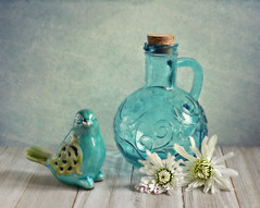 A Turquoise Theme (Through Serena's Lens) Tags: lifeisarainbow bird ceramic figurine turquoise blue bottle glass flower chrysanthemums tabletop texture stilllife closeup 7dwf