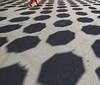 Holes (CoolMcFlash) Tags: vienna strase streetphotography shadow holes person walking canon eos 60d pattern texture ground asphalt wien schatten löcher gehen muster textur boden fotografie photography abstract abstrakt sigma 1020mm 35 city stadt