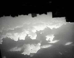 Black & white (afs.harp) Tags: black white sky clouds building city out inverse over backward