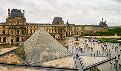 The Louvre In The Rain (szeke) Tags: museum louvre paris france architecture building rain people landmark