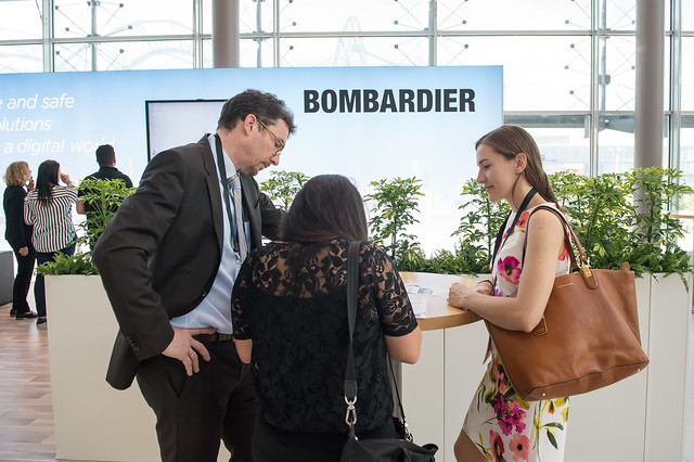 Attendees visiting the Bombardier stand