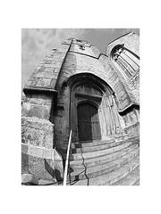 church door (chrisinplymouth) Tags: architecture building church tower stone door standrews plymouth devon england uk fisheye monochrome black white cw69x wb steps distortion plymgrp