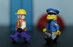 The Joker's henchman is on the run (N.the.Kudzu) Tags: tabletop lego minifigures henchman simpsons cop primelens canondslr canon50mmf18 extensiontube