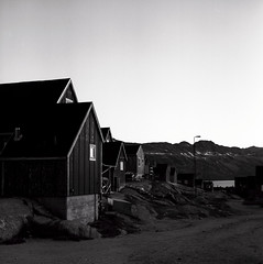 Kuummiit dusk (Úlfur Björnsson) Tags: bw black white medium format film 6x6 mamiya 80mm f28 sekor ilford hp5 plus 400 120 analog houses greenland trip travel dusk sunset kuummiit house