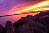 Colours in the sky and the water (anthonydcliffe) Tags: sunset nature warm lake ocean water sky clouds dusk landscape canada pei charlottetown travel rocks reflection