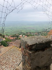 "From the City Hall bell tower before the rain (Herculeus.) Tags: medieval stonework rooftops fields haze outdoors outdoor outside roofs ""belltower"" tuscany landscape buildings ""cityhall"" italy volterra tower tour"