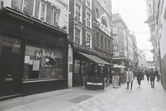 London (goodfella2459) Tags: nikon f4 bergger pancro 400 35mm blackandwhite film analog london city street buildings shops pedestrians people bwfp