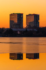 twins (Adrian Mitu) Tags: bucharest water reflection outdoors twins buildings sun sunset golden hour sky yellow orange glow