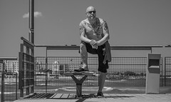 Holiday pose. (CWhatPhotos) Tags: cwhatphotos cyprus protaras eastern pose shades sunglasses sun look tattoo tattooed bw portrait man male sunny day waters 2018 april digital camera pictures picture image images photo photos foto fotos that have which contain olympus seafront golden coast beach blue sky skies holiday water sea deep color colour 43 micro four thirds penf