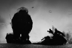 Captain Radiohead (Mikhail Korolkov) Tags: street puddle reflection rain circles silhouette fujifilm xe2 xf50mmf20