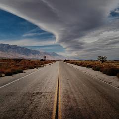 Racing the Storm (Maureen Bond) Tags: ca maureenbond lines clouds storm cold joshuatree roadtrip highway sierra