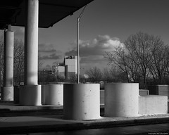 on the highway heading to Chicagoo (Furcletta) Tags: usa grey concrete architecture 50mm18g calumetil clouds handheld nikond800 outdoor shadow sky winter blackwhite highway tree construction pillar