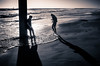 Cold Feet (mcook1517) Tags: beach pier huntingtonbeach california shoreline seascape landscape people environment sand footsteps shadows backlit water ocean pacific travel tourism escape