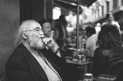 man with cigar (andrewlance photography) Tags: ibelieveinfilm ilovemyleica filmisnotdead 100 2015 35 35mm 50mm australia cc delta f20 ilford lr lr6 leica lightroom lightroom6 m m3 man melbourne photoshop professional summicron analogue bw beard blackandwhite blackwhite bnw cafe cigar cigarette drink film glasses grain mono monochrome monocrome myflickr noiretblanc phone sit smoke steetphoto street streetphotography suit