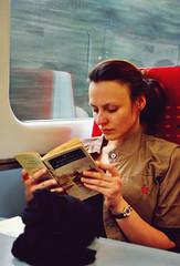 20110129 A moving novel ([Ananabanana]) Tags: nikon d40 gimp photoscape 1855mm 1855 nikkor nikon1855mmkitlens nikkorafsdx1855mm nikonafsdx1855mm nikkor1855mm nikon1855mm nikonistas nikonista nottingham nottinghamshire notts uk unitedkingdom train trains railway eastmidlands eastmidlandstrains reading book heartofdarkness josephconrad travelreading novel portrait woman