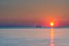 Sail Away (roelbleeker) Tags: sun sunset blue boat sea seascape red reflection yellow orange purple pink netherlands nederland nikon d750 nikond750 2401200mmf40 2401200mm exposure longexposure scheveningen