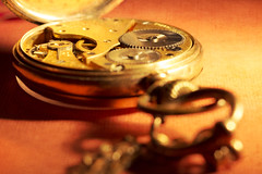 More time (alideniese) Tags: closeup macro stilllife watch pocketwatch time timepiece gold metal alideniese bokeh colour colourful light shadow texture focus round chain orange yellow inside mechanism parts tabletop old antique vintage