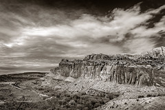 Capitol Reef National Park (EdBob) Tags: capitolreef waterpocketfold nationalpark utah blackwhite blackandwhite sepia toned southwest americansouthwest desert rock geology geological clouds sky monochrome monochromatic cliff stone environment travel tourism view viewpoint scenic scenery overlook fruita edmundlowephotography edmundlowe mormon orchard usa america allmyphotographsare©copyrightedandallrightsreservednoneofthesephotosmaybereproducedandorusedinanyformofpublicationprintortheinternetwithoutmywrittenpermission