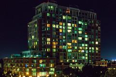 San Jose at night (bior) Tags: sanjose night longexposure towers apartment skyline cityatnight ef50mmf14usm canoneosrebel2000 rebel2000 50mm kodakektachrome ektachrome e50t expiredfilm slidefilm